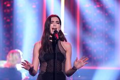 "English singer-songwriter Dua Lipa performed a new song ""Hotter Than Hell"" on The Tonight Show starring Jimmy Fallon."