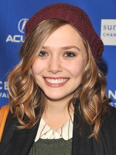 If only I could get my hair to curl this nicely. I don't think I could pull off a beanie though.