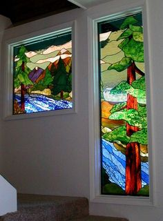 Windows on a stairway - I love the mountain scene and the water is beautiful!