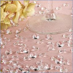 These clear diamonds strewn around the tea table add to our royalty theme.