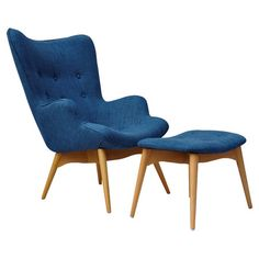 Pairing a classic midcentury design with bold blue upholstery, this eye-catching chair and ottoman set brings retro-chic charm to any space. Its vibrant hue ...
