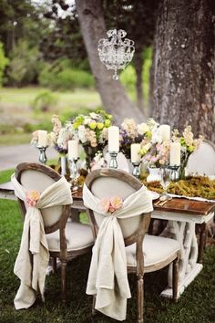 pretty chandelier and flower and candle arrangement on the table