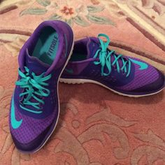 NIKE FITSOLE PURPLE & TEAL 8.5 Super comfortable and stylish NIKE FITSOLE shoes in a size 8.5/40. Purple with teal accents! Minor walk wear on soles but should clean up and look brand new! Nike Shoes Athletic Shoes