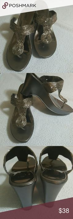 Carlos Santana gray sandals 7.5 gray sandals, about 3.5 inches high, gently used. Cute with jeans or dresses! Carlos Santana Shoes Sandals