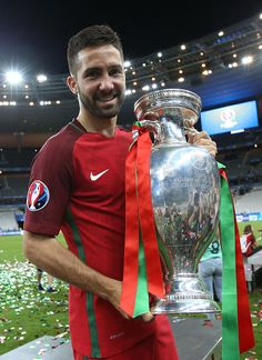 #EURO2016 Joao Moutinho of Portugal poses with the trophy following the UEFA Euro 2016 final match between Portugal and France at Stade de France on July 10...