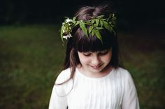 Flower girl wears fresh flower crown. Photography by http://www.lucylittle.co.uk/