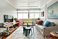 Mix entre o antigo e o novo transforma apartamento