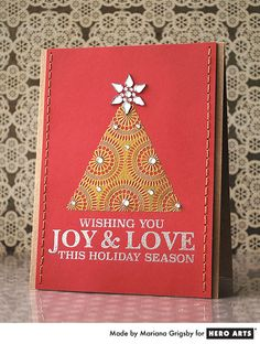 Joy & Love  By Mariana Grigsby - Scrapbook.com - Beautifully embossed card made with Hero Arts supplies.
