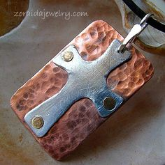 Copper, brass, aluminum and sterling cross pendant
