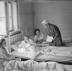 THE LIBERATION OF BERGEN-BELSEN CONCENTRATION CAMP, APRIL 1945. A British social worker attached to the French Relief Service, Miss Joyce Parkinson from Croydon, with former women camp inmates, now hospital patients at Camp No 2, Hohne Military Barracks.