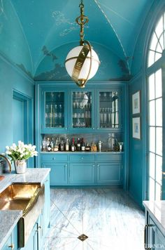 Love it all- ceiling  vaulting and hand painted constellations, thematically relavant light fixture, intense turquoise color, brass sink, meticulous floor installation to the beautiful center drain... everything is perfect.