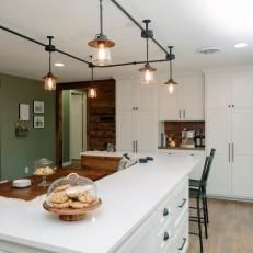Industrial Track Lighting Over Eat In Dining Area In Open Country Kitchen