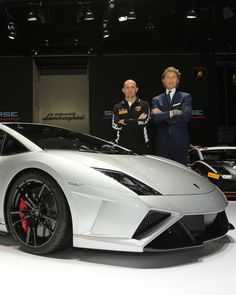 CEO and President of Automobili Lamborghini Stephan Winkelmann and Chief Test Driver Giorgio Sanna with Gallardo LP 570-4 Squadra Corse at 2013 Frankfurt Motor Show.