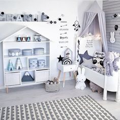 A gender neutral kids room with a whimsical monochrome design theme. A gender neutral kids room with a whimsical monochrome design theme.