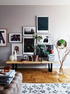 GORGEOUS grey walls, art prints and photography gallery wall, bench with books, plants and objets. Photo by Jonas Ingerstedt Photography.