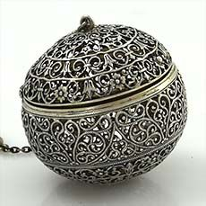 """Rare Shiebler Hand Made Filigree Tea Ball. A most unusual oversize antique sterling tea ball with hinged top and intricate hand assembled filigree work. There is a band of gilding to highlight the opening. In excellent condition and a superb large tea ball. 2"""" diameter."""