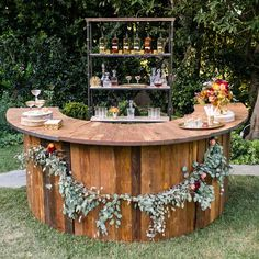 The circular shape of this richly distressed bar creates a cozy and inviting atmosphere, ideal for guests to gather 'round in celebration.
