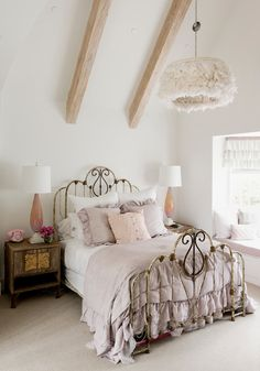 A classic iron #bed frame, vintage bedroom #furniture and stunning #light. Makes for a beautiful Shabby Chic #bedroom.