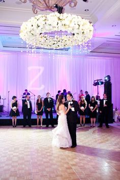 A halo of heavenly white blooms hung over this @Four Seasons Resort and Club Dallas at Las Colinas couple's heads during their first dance.