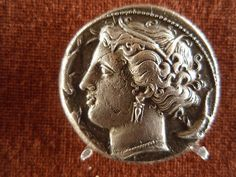 Syracuse, Sicily, AR tetradrachm. Portrait of the nymph Arethusa, with dolphins surrounding.