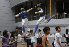 Two 5-meter-tall figures of Misaki, left, and Tsubasa, characters from the Japanese football comic Captain Tsubasa, are displayed outside a shopping mall in Hong Kong, Saturday, June 7, 2014 to promote the upcoming 2014 World Cup soccer tournament in Brazil. (AP Photo/Kin Cheung) ▼7Jun2014APviaYahoo!News http://news.yahoo.com/photos/two-5-meter-tall-figures-misaki-left-tsubasa-photo-105630175.html #Captain_Tsubasa