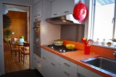 Small Kitchen design.  This pic shows the stove hood.  I like the orange countertop (but not for Francie's kitchen).