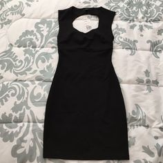Forever 21 Black Dress NWT. Little black dress with showstopping criss cross back. Perfect for a night out. Size S. SORRY, NO TRADES OR PAYPAL TRANSACTIONS. Forever 21 Dresses