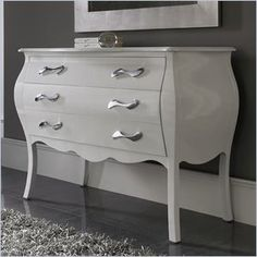 Dupen Nelly Dresser in White - The Nelly collection will create a visual fantasy in your bedroom using traditional shapes in the modern interpretation.  Features: This collection combines wood, leather and metal to lend a special and remarkable elegance. Made in Spain  Specifications: Product Weight: 141lbs Overall Product Dimensions: 34H x 45W x 20D