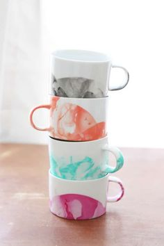 DIY marbled mugs with nail polish - learn how to make this easy craft project, and get tips and tricks. So fun and a great gift idea!