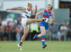 Erin Phillips Photos Photos - Ebony Marinoff of the Crows (centre) sings the team song with Stevie-Lee Thompson (left) and Erin Phillips of the Crows during the 2017 AFLW Round 02 match between the Western Bulldogs and the Adelaide Crows at VU Whitten Oval on February 10, 2017 in Melbourne, Australia. - AFL Women's Rd 2 - Western Bulldogs v Adelaide Crows