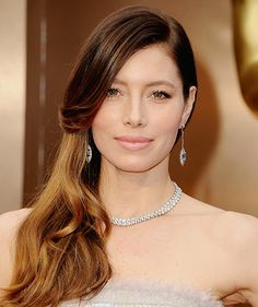 """Jessica Biel: Hairstylist Mara Roszak was inspired by """"old Hollywood glam,"""" so she curled the bottom half of Biel's locks with a 1 ½-inch curling iron, then applied L'Oreal Paris' Advanced Hairstyle Sleek It Strand-Smoother Serum Spray ($5) for a shiny finish  at the 86th Annual Academy Awards. #JessicaBiel #Oscars #RedCarpet"""