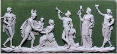 White on green dipped jasperware plaque depicting the Triumph or Birth of Bacchus, modelled in about 1776 by William Hackwood. The plaque was the subject of debate in a series of letters from Wedgwood at Etruria, to Bentley in London.