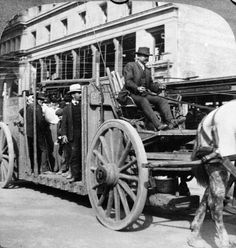 Half of a stereoscopic image of a man driving a roofless horse-drawn bus underneath cablecar wires on the streets of San Francisco as passengers stand in the back in the aftermath of the San Francisco earthquake and citywide fires, San Francisco, California, 1906. Photo: Hulton Archive, Getty Images / 2005 Getty Images