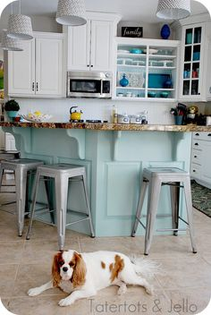 aqua & white kitchen. she used martha stewart's rainwater for the island color--love the blues!
