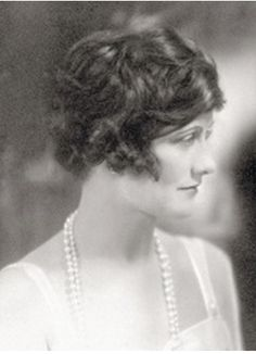 Young Coco Chanel (1920) even early in her designing career...Coco wore her signature pearls with everything ...day or evening....