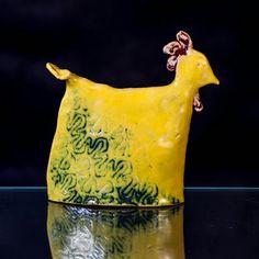 Ceramics sculpture. Ceramics chicken. Clay sculpture. Yellow chicken.