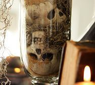 1.  Purchase cheap skulls from $ Tree,          2.  collect moss from tress....instant decor!