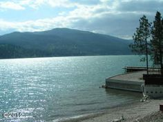 MLS# 312512 Great opportunity to own .67 acres w/ 96 feet of lake front in the highly sought after woods bay area. this property has a 1406 sq ft. foundation that is grandfathered sitting right on the waters edge. this is a must see as you will not be able to beat this location on flathead lake. also included is a 31x22 garage/shop . there is a well on the property. Equal Housing Opportunity. Information deemed reliable but not guaranteed by National Parks Realty. Listed by: Mike Anderson