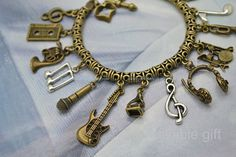 Steampunk Music Charms Bracelet,antique brass Musicial theme bracelet with tape,trumpet,guitar,headset,drum set,violin etc charms BMN01