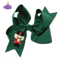 Perfect Christmas gift for a ballet dancer! Our embroidered nutcracker hairbow comes in a variety of sizes, including our jumbo hair bow. You can customize this Christmas bow clip with the ribbon color and hair clip of your choosing. Available in 8 colors and on french barrette, alligator clip or ponyO elastic. It has been beautifully crafted out of quality Made in the USA grosgrain ribbon that is slightly twisted for that classic boutique bow shape that won't lie too flat when worn. Christmas Hair Bows, Family Christmas Cards, Perfect Christmas Gifts, Christmas Outfits, Big Hair Bows, Bow Shop, Christmas Accessories, Nutcracker Christmas, Boutique Bows