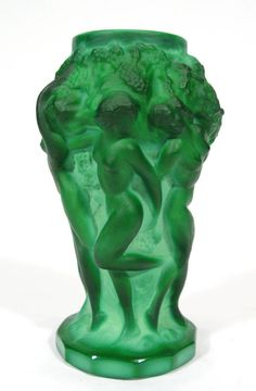 Green opalescent Desna glass vase, moulded with nude maidens supporting grapevines, etched mark to base, by Frantisek Pazourek.