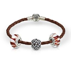 Pandora leather bracelet and charms. Available at S.E. Needham Jewelers.