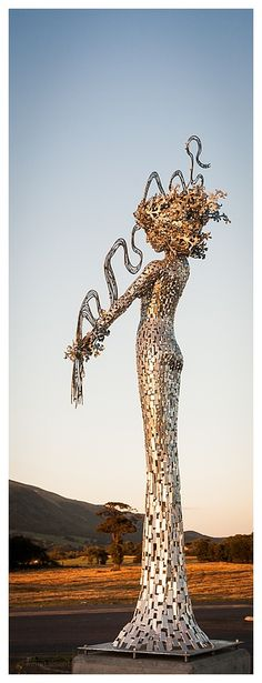 """""""River Spirit Showing the Forth"""" sculpture by Andy Scott - The metal lady holds a squiggle that forms a """"map"""" of the River Forth (a 29 mile long river in Scotand) in Clackmannanshire, Scotland."""
