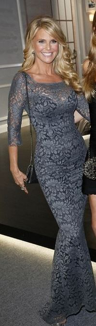 Who made Christie Brinkley's gray long sleeve lace gown?
