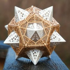 """Architect and designer Thomas Houha tells us that the technical term for his ingenious Star Orb is a """"stellated dodecahedron inside a dodecahedron."""" Whether or not you understand the mind-blowing geometry behind the Star Orb, you'll be surprised both by how easy it is to put together and how impressive the finished project is. #colossal"""
