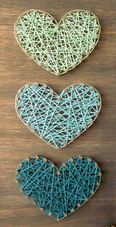 Handmade mini wooden sign with string art.