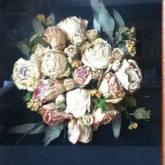 After drying out my bridal bouquet, I selected the best blooms and hot glued them to thick black paper for display in a shadow box in my mum's kitchen.
