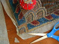 """My favorite way to finished my hooked rugs is with a crochet edge. This edge is often mistaken for braiding. I use extra long strips for this process, 60 inches or longer. Cut them to either 1/4 inch wide or a bit narrower-- a #7 or #8 cut works well. Use one color, or many different colors to border your design.   If you watch this as a slide show, please note that you can also click on individual photos for further explanation. Or click on """"detail view"""" below to see all the photo..."""