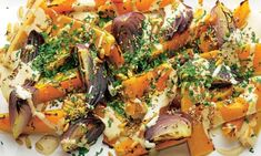 Yotam Ottolenghi's roasted butternut squash and red onion with tahini and za'atar: A great vegetarian treat to grace the Christmas table. Photograph: Colin Campbell for the Guardian