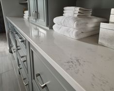 Quartz countertops can offer an authentic marble look-a-like that is easy to maintain, affordably priced, and extremely durable. Quartz Kitchen Countertops, Granite Tile, Kitchen Backsplash, Quartz Slab, Shower Surround, White Quartz, White Marble, Carrara, New Kitchen